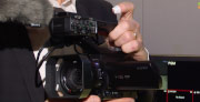 Sony HXR-MC88 palm-sized camcorder shown plus UWP series wireless transmission at NAB 2019